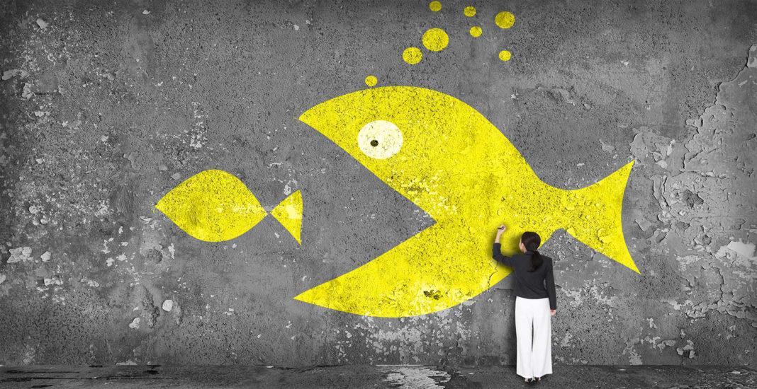 Lutech - Concetto di acquisizione, un pesce grande mangia un pesce piccolo