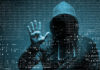 Young hacker in cybercrime concept